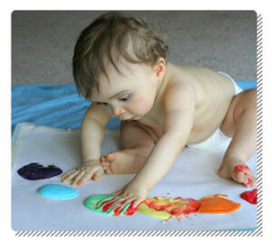 Baby Playing with Edible Painting