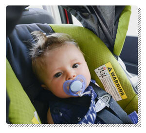 Baby Using a Pacifier in the Car
